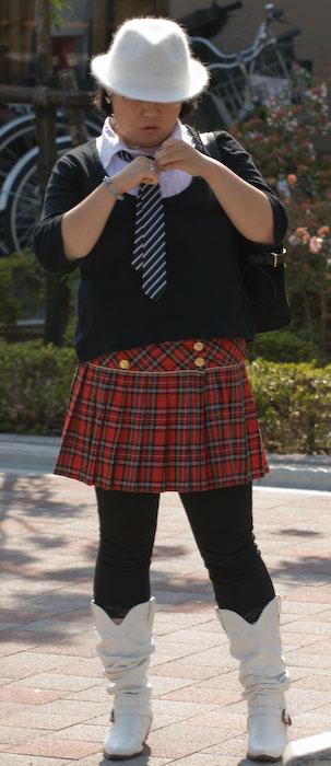 Japanese woman with a severe lack of style sense, wearing the most grotesquely comical combination of clothes