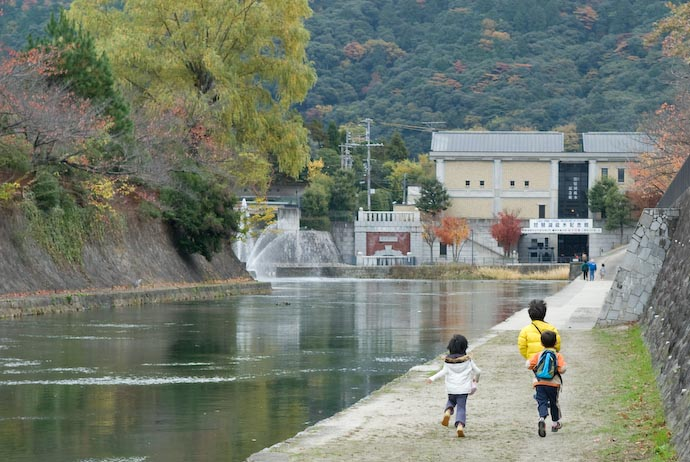 Kids running along the banks of the Kyoto Biwako Canal, Kyoto Japan