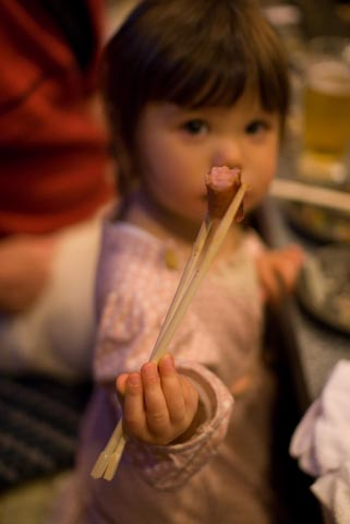Nikon D200 + Sigma 30mm f/1.4 — 1 / 80 sec, f/1.4, ISO 640 — map & image data Two-year-old using chopsticks -- Kyoto, Japan -- Copyright 2007 Jeffrey Eric Francis Friedl, http://regex.info/blog/