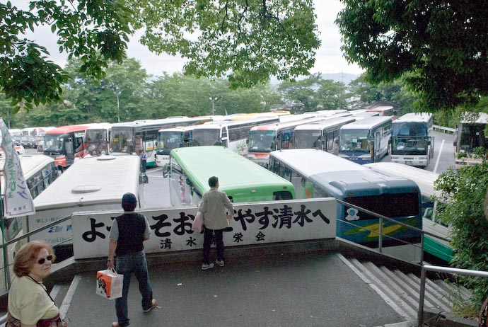 Small Portion of the Parking Lot Which can hold 51 full-length tourist busses, in addition to numerous cars and the mini busses like those in the foreground here. -- Kyoto, Japan -- Copyright 2007 Jeffrey Eric Francis Friedl, http://regex.info/blog/