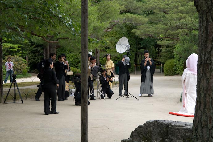 Bridal Photoshoot in the Garden That's the groom with the tiny camera at right -- Kyoto, Japan -- Copyright 2007 Jeffrey Eric Francis Friedl, http://regex.info/blog/
