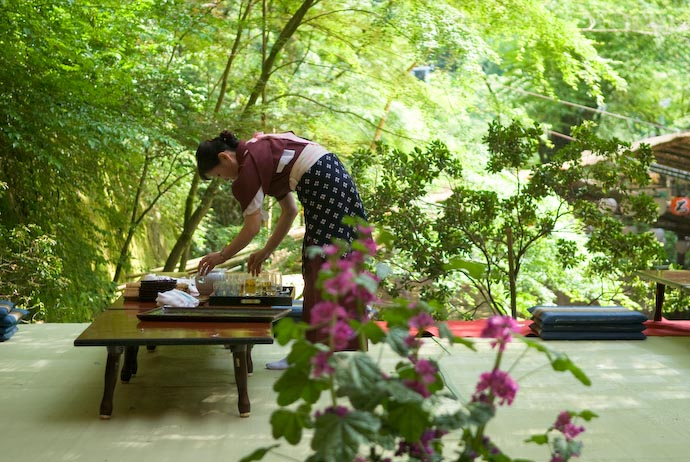 Waitress Tidies Up on the Lower Platform -- Kyoto, Japan -- Copyright 2007 Jeffrey Eric Francis Friedl, http://regex.info/blog/