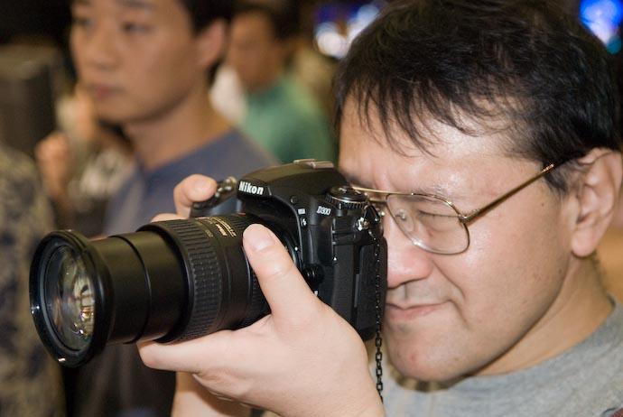 Shimada-san Tries the Nikon D300 With Nikkor 18 -200VR -- Osaka, Japan -- Copyright 2007 Jeffrey Eric Francis Friedl