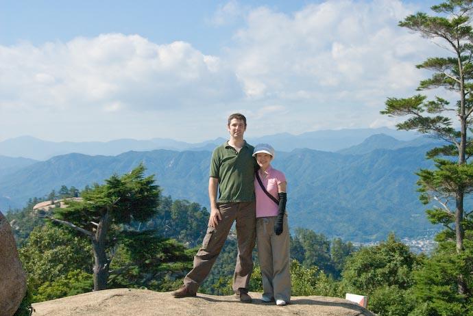 Me and Fumie kindly taken by an Australian wearing a silly hat -- Miyajima, Hiroshima, Japan -- Copyright 2007 Jeffrey Eric Francis Friedl