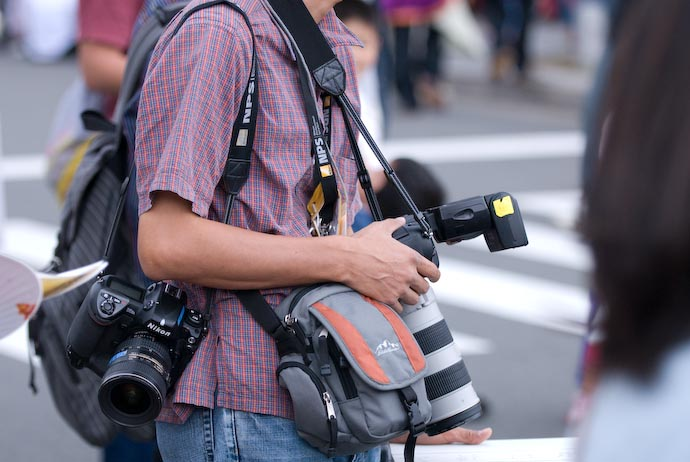 Reporter with two Nikon D2 Hs Camera Bodies -- Kyoto, Japan -- Copyright 2007 Jeffrey Eric Francis Friedl