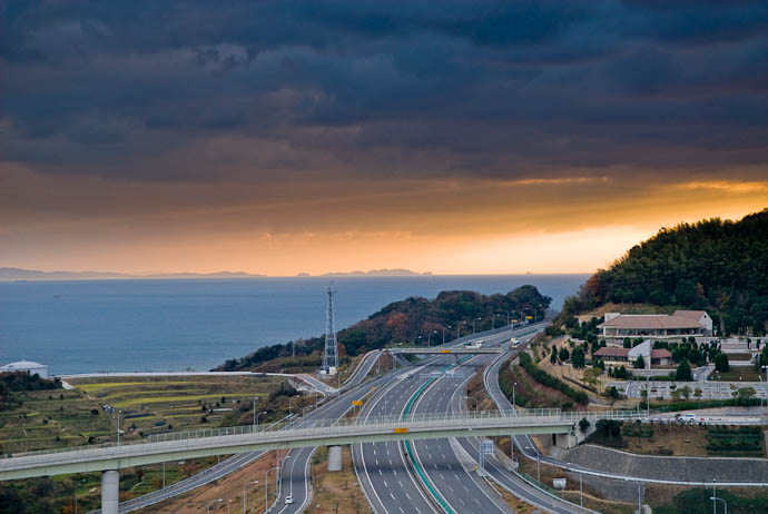 Looking South a bit of spark in the sunset brightens up a dreary day -- Awaji, Hyougo, Japan -- Copyright 2007 Jeffrey Eric Francis Friedl, http://regex.info/blog/