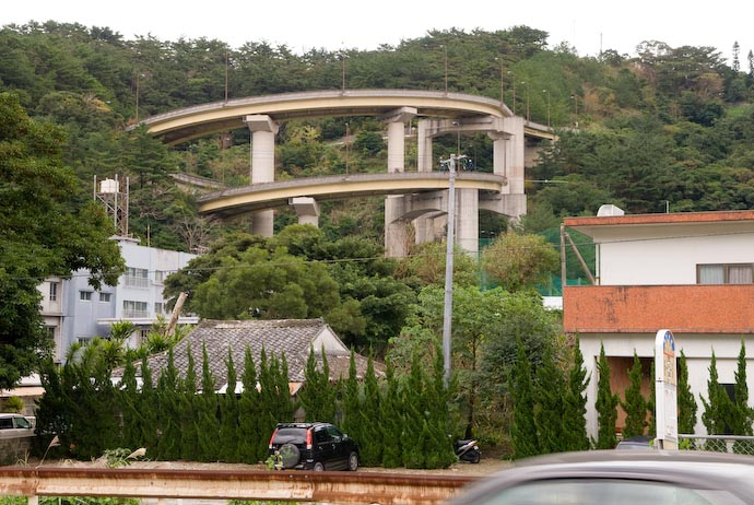 A loop-de-loop-de-loop -- an elevated road/bridge loops two full times as it descends a steep hill, in Naze, on Amami-ooshima, an island in southern Japan