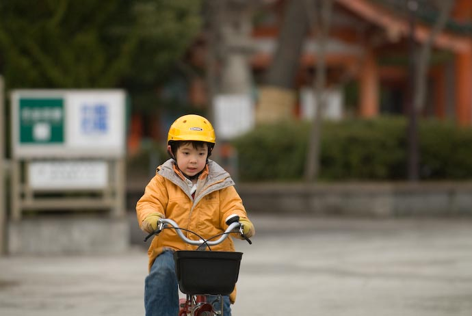 Concentration (he was pretending to be in a race) -- Kyoto, Japan -- Copyright 2008 Jeffrey Eric Francis Friedl