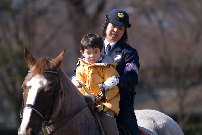 Anthony Rides a Police Horse -- Kyoto, Japan -- Copyright 2008 Jeffrey Eric Francis Friedl, http://regex.info/blog/