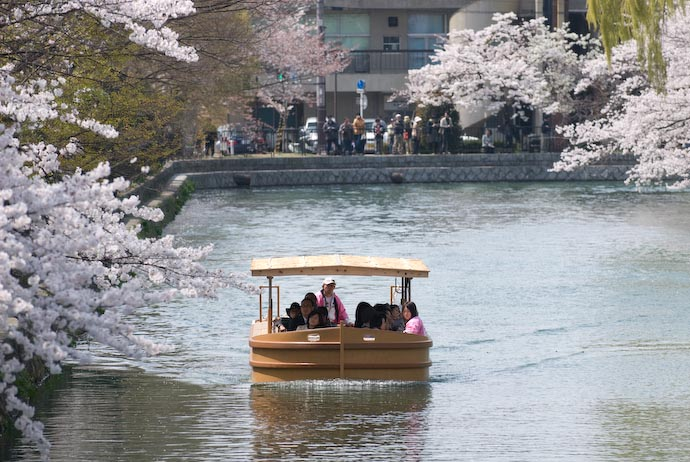 Blossom-Viewing Boat as seen from where the couple above was standing -- Kyoto, Japan -- Copyright 2008 Jeffrey Eric Francis Friedl