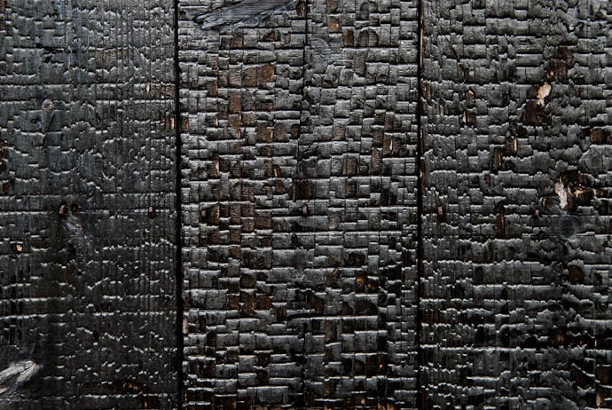 desktop background image of a wooden wall of an old Japanese garden, purposfully burnt to cinder (perhaps for aestetics, or to deter insect damage) -- Wall, Burnt to a Crisp on purpose -- Kyoto, Japan -- Copyright 2008 Jeffrey Eric Francis Friedl, http://regex.info/blog/