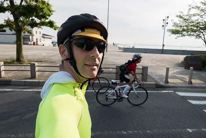 "My Attempt at a "" Selfie "" 6:23 AM (+57 min) - 14 km (8.4 miles) taken while cycling at 18 kph (11 mph) -- Otsu, Shiga, Japan -- Copyright 2015 Jeffrey Friedl, http://regex.info/blog/"
