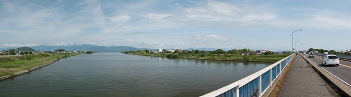 Passing Over an Inlet River click through for a wide panorama 9:05 AM (+3h 39m) - 65 km (40.3 miles) taken while cycling at 23 kph (14 mph) -- Higashiomi, Shiga, Japan -- Copyright 2015 Jeffrey Friedl, http://regex.info/blog/ -- This photo is licensed to the public under the Creative Commons Attribution-NonCommercial 4.0 International License http://creativecommons.org/licenses/by-nc/4.0/ (non-commercial use is freely allowed if proper attribution is given, including a link back to this page on http://regex.info/ when used online)