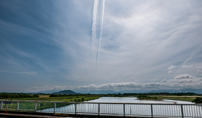 Interesting Sky I like the shadow of the contrail on the apparently-slightly-lower layer of clouds 9:06 AM (+3h 39m) - 65 km (40.4 miles) taken while cycling at 24 kph (15 mph) -- Higashiomi, Shiga, Japan -- Copyright 2015 Jeffrey Friedl, http://regex.info/blog/ -- This photo is licensed to the public under the Creative Commons Attribution-NonCommercial 4.0 International License http://creativecommons.org/licenses/by-nc/4.0/ (non-commercial use is freely allowed if proper attribution is given, including a link back to this page on http://regex.info/ when used online)