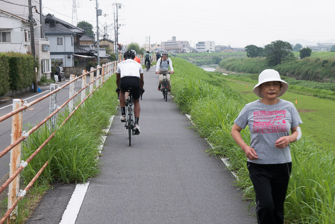 """ All the Happiness "" on a well-used path away from traffic 7:54 AM (+25 min) - 9.7 km (6.0 miles) taken while cycling at 29 kph (18 mph) -- Kyoto, Japan -- Copyright 2015 Jeffrey Friedl, http://regex.info/blog/"