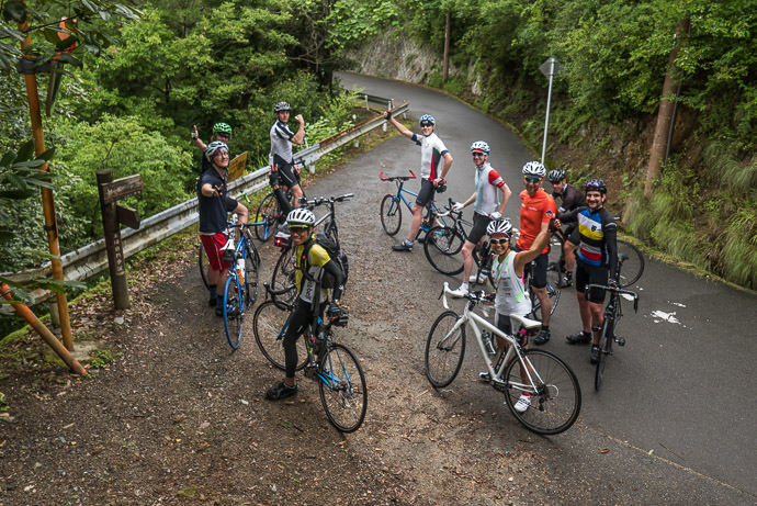 Large Group Ride pausing after the first steep climb in the mountains above the Arashiyama area of Kyoto, Japan -- Copyright 2015 Jeffrey Friedl, http://regex.info/blog/