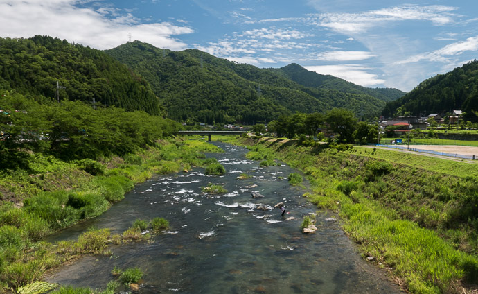 Picturesque River like so many of them tucked among the mountains of Japan, filled with fly fishermen 10:13 am (from start: 5h 49m / 77 km / 47.7 miles) taken while cycling at 13 kph (8 mph) -- Oi-gun, Fukui, Japan -- Copyright 2015 Jeffrey Friedl, http://regex.info/blog/