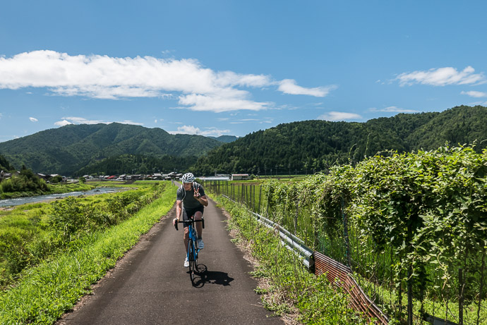 Crossing a Small Valley 10:38 am (from start: 6h 14m / 79 km / 48.9 miles) 10:38am - taken while cycling at 24 kph (15 mph) -- Oi-gun, Fukui, Japan -- Copyright 2015 Jeffrey Friedl, http://regex.info/blog/