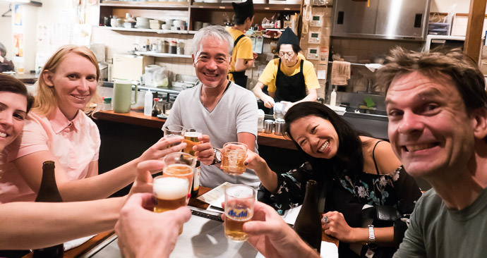 "Kanpai! ( "" cheers "" ) at Kiraku (きらく 三条本店) -- Kiraku (きらく三条本店) -- Kyoto, Japan -- Copyright 2015 Jeffrey Friedl, http://regex.info/blog/"