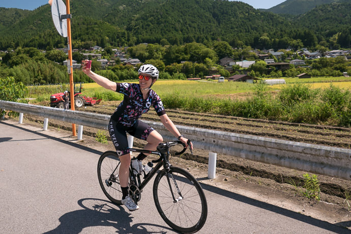 Bridget Selfie in the Ohara village of Kyoto taken while cycling at 16 kph (10 mph) -- Kyoto, Japan -- Copyright 2015 Jeffrey Friedl, http://regex.info/blog/
