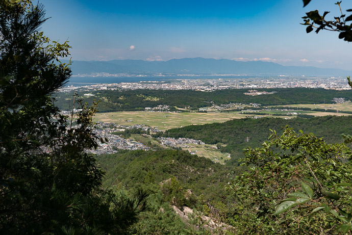 View of Otsu and Lake Biwa from the pass on Mt. Tanokami (田上山) -- Mt. Tanokami (田上山) -- Otsu, Shiga, Japan -- Copyright 2015 Jeffrey Friedl, http://regex.info/blog/
