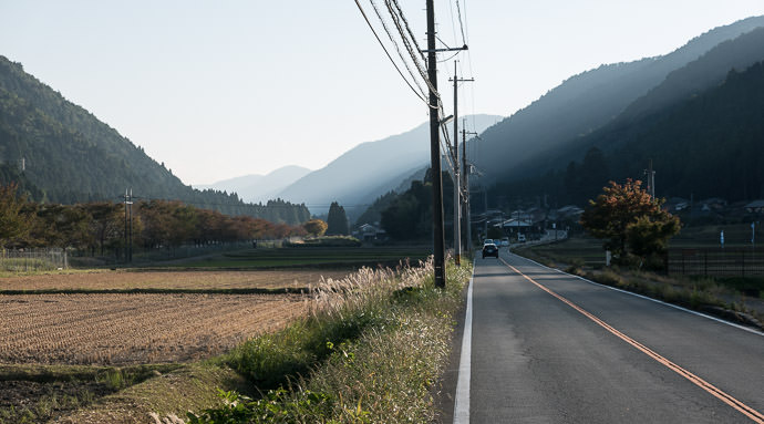 Sun Dipping Behind the Mountains -- Takashima, Shiga, Japan -- Copyright 2015 Jeffrey Friedl, http://regex.info/blog/ -- This photo is licensed to the public under the Creative Commons Attribution-NonCommercial 4.0 International License http://creativecommons.org/licenses/by-nc/4.0/ (non-commercial use is freely allowed if proper attribution is given, including a link back to this page on http://regex.info/ when used online)