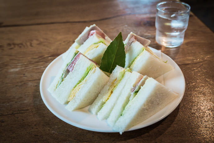 """ Mixed Sandwich "" nondescript mostly-bread sandwich; common in Japan -- Takashima, Shiga, Japan -- Copyright 2015 Jeffrey Friedl, http://regex.info/blog/ -- This photo is licensed to the public under the Creative Commons Attribution-NonCommercial 4.0 International License http://creativecommons.org/licenses/by-nc/4.0/ (non-commercial use is freely allowed if proper attribution is given, including a link back to this page on http://regex.info/ when used online)"
