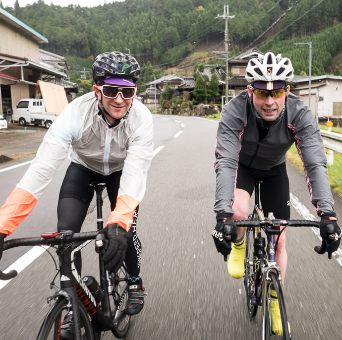 Andy and Christoph taken while cycling at 34 kph (21 mph) -- Kyoto, Japan -- Copyright 2015 Jeffrey Friedl, http://regex.info/blog/