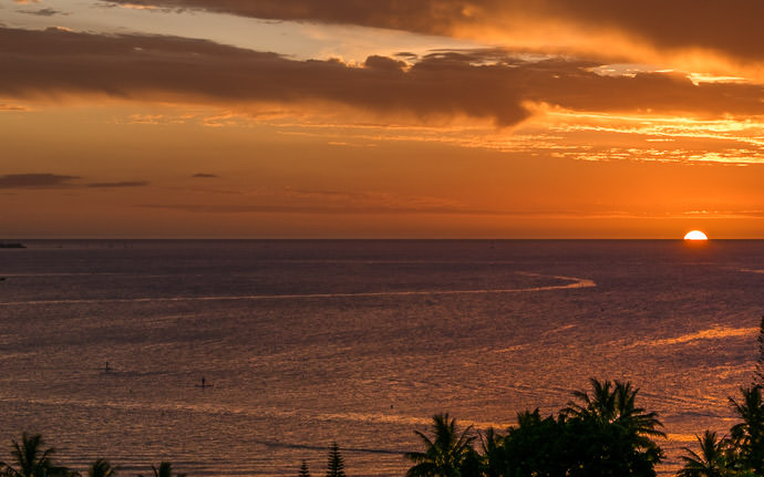 desktop background image of a sunset in Nouméa, New Caledonia -- Typical Sunset Two stand-up paddle boarders (lower left) on calm waters Nouméa, New Caledonia -- Hilton Nouméa -- Nouméa, South, New Caledonia -- Copyright 2015 Jeffrey Friedl, http://regex.info/blog/ -- This photo is licensed to the public under the Creative Commons Attribution-NonCommercial 4.0 International License http://creativecommons.org/licenses/by-nc/4.0/ (non-commercial use is freely allowed if proper attribution is given, including a link back to this page on http://regex.info/ when used online)