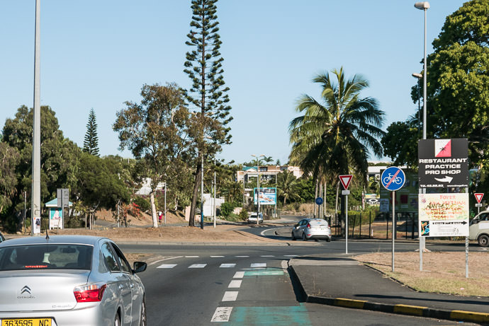"A Roundabout with an "" end of bicycle path "" sign upon entrance, and in the background a "" start of bicycle path "" sign upon exit taken while cycling at 18 kph (11 mph) -- Nouméa, South, New Caledonia -- Copyright 2015 Jeffrey Friedl, http://regex.info/blog/ -- This photo is licensed to the public under the Creative Commons Attribution-NonCommercial 4.0 International License http://creativecommons.org/licenses/by-nc/4.0/ (non-commercial use is freely allowed if proper attribution is given, including a link back to this page on http://regex.info/ when used online)"