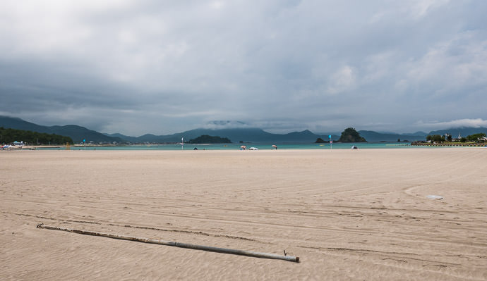 Quiet Wakasawada Beach (若狭和田海水浴場) 12:35pm - taken while cycling at 16 kph (10 mph) -- Wakasawada Beach (若狭和田海水浴場) -- Takahama, Fukui, Japan -- Copyright 2016 Jeffrey Friedl, http://regex.info/blog/ -- This photo is licensed to the public under the Creative Commons Attribution-NonCommercial 4.0 International License http://creativecommons.org/licenses/by-nc/4.0/ (non-commercial use is freely allowed if proper attribution is given, including a link back to this page on http://regex.info/ when used online)