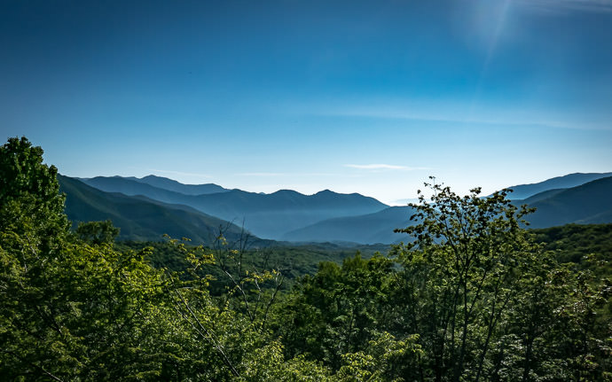 desktop background image of a mountain landscape taken from Mt. Norikura in Japan (乗鞍の景色) -- Glorious Weather 7:11am -- Mt. Norikura (乗鞍岳) -- Matsumoto, Nagano, Japan -- Copyright 2016 Jeffrey Friedl, http://regex.info/blog/ -- This photo is licensed to the public under the Creative Commons Attribution-NonCommercial 4.0 International License http://creativecommons.org/licenses/by-nc/4.0/ (non-commercial use is freely allowed if proper attribution is given, including a link back to this page on http://regex.info/ when used online)
