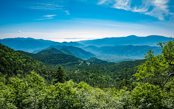 desktop background image of a mountain landscape taken from Mt. Norikura in Japan (乗鞍の景色) -- Looking Back to where we started -- Mt. Norikura (乗鞍岳) -- Matsumoto, Nagano, Japan -- Copyright 2016 Jeffrey Friedl, http://regex.info/blog/ -- This photo is licensed to the public under the Creative Commons Attribution-NonCommercial 4.0 International License http://creativecommons.org/licenses/by-nc/4.0/ (non-commercial use is freely allowed if proper attribution is given, including a link back to this page on http://regex.info/ when used online)