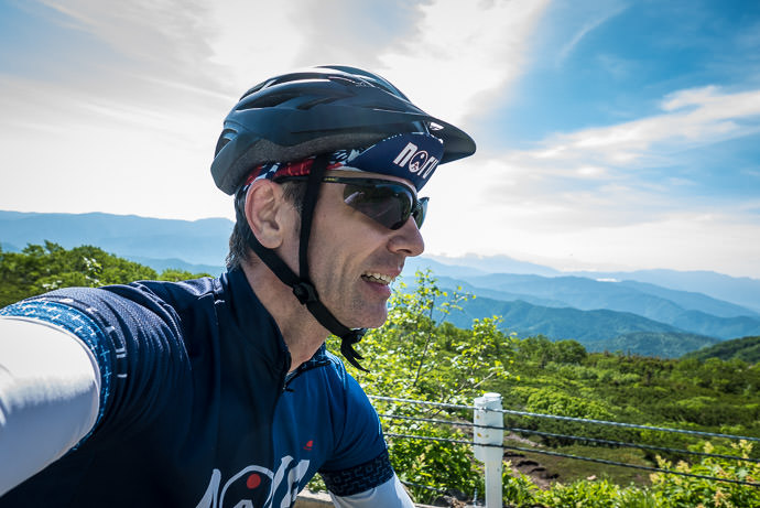 Attempt at a Selfie I'm not as good as Gorm at it 8:34am - taken while cycling at 10 kph (6 mph) -- Mt. Norikura (乗鞍岳) -- Matsumoto, Nagano, Japan -- Copyright 2016 Jeffrey Friedl, http://regex.info/blog/
