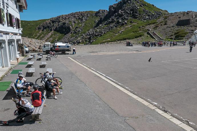 "Taking a Well -Earned Break 9:25am — the "" long ride "" group we still have 140km (87mi) left to ride -- Mt. Norikura (乗鞍岳) -- Takayama, Gifu, Japan -- Copyright 2016 Jeffrey Friedl, http://regex.info/blog/"