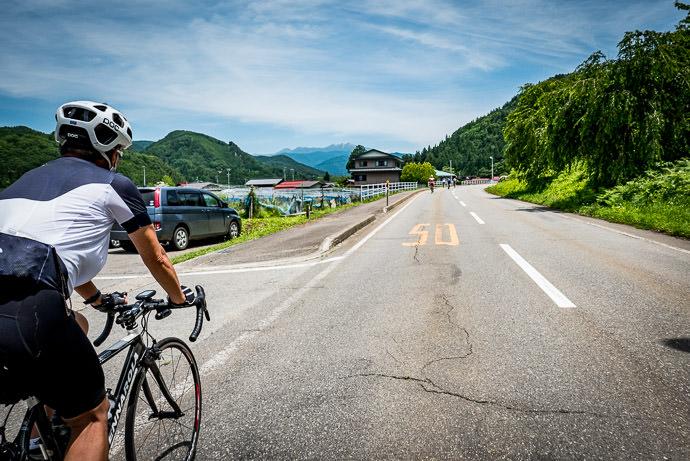 Mt. Norikura Comes Back into View 12:33pm - taken while cycling at 18 kph (11 mph) -- Takayama, Gifu, Japan -- Copyright 2016 Jeffrey Friedl, http://regex.info/blog/