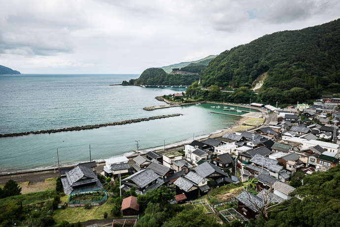 Typical Village nestled in a cove -- Obama, Fukui, Japan -- Copyright 2016 Jeffrey Friedl, http://regex.info/blog/ -- This photo is licensed to the public under the Creative Commons Attribution-NonCommercial 4.0 International License http://creativecommons.org/licenses/by-nc/4.0/ (non-commercial use is freely allowed if proper attribution is given, including a link back to this page on http://regex.info/ when used online)