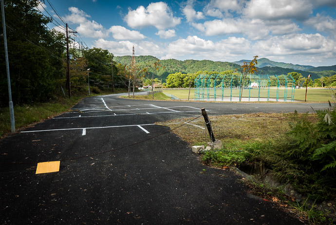 Civilization opens out into a park area with a baseball field グリーンパーク -- Takashima, Shiga, Japan -- Copyright 2016 Jeffrey Friedl, http://regex.info/blog/ -- This photo is licensed to the public under the Creative Commons Attribution-NonCommercial 4.0 International License http://creativecommons.org/licenses/by-nc/4.0/ (non-commercial use is freely allowed if proper attribution is given, including a link back to this page on http://regex.info/ when used online)