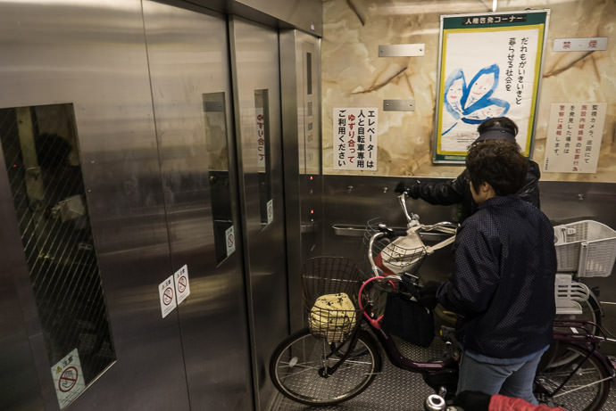 Going Down Elevator to an underground tunnel -- Osaka, Japan -- Copyright 2017 Jeffrey Friedl, http://regex.info/blog/ -- This photo is licensed to the public under the Creative Commons Attribution-NonCommercial 4.0 International License http://creativecommons.org/licenses/by-nc/4.0/ (non-commercial use is freely allowed if proper attribution is given, including a link back to this page on http://regex.info/ when used online)