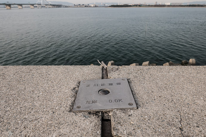 """ Yodo River Distance Marker "" Left Bank 0.0 Kilometers -- Osaka, Japan -- Copyright 2017 Jeffrey Friedl, http://regex.info/blog/ -- This photo is licensed to the public under the Creative Commons Attribution-NonCommercial 4.0 International License http://creativecommons.org/licenses/by-nc/4.0/ (non-commercial use is freely allowed if proper attribution is given, including a link back to this page on http://regex.info/ when used online)"