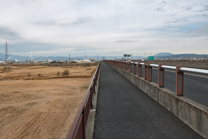 Long, Flat Bridge over the Uji-River flood plain -- Kyoto, Japan -- Copyright 2017 Jeffrey Friedl, http://regex.info/blog/ -- This photo is licensed to the public under the Creative Commons Attribution-NonCommercial 4.0 International License http://creativecommons.org/licenses/by-nc/4.0/ (non-commercial use is freely allowed if proper attribution is given, including a link back to this page on http://regex.info/ when used online)