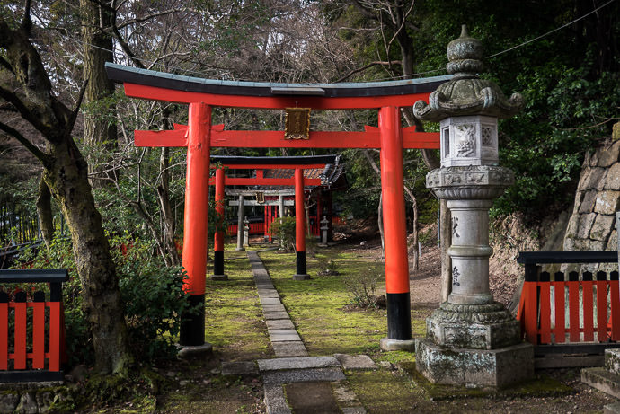 Small Shrine on the steep road to a temple (Yamazaki Shouten / 山崎聖天) -- Yamazaki Shouten (山崎聖天) -- Yamazaki, Kyoto, Japan -- Copyright 2017 Jeffrey Friedl, http://regex.info/blog/ -- This photo is licensed to the public under the Creative Commons Attribution-NonCommercial 4.0 International License http://creativecommons.org/licenses/by-nc/4.0/ (non-commercial use is freely allowed if proper attribution is given, including a link back to this page on http://regex.info/ when used online)