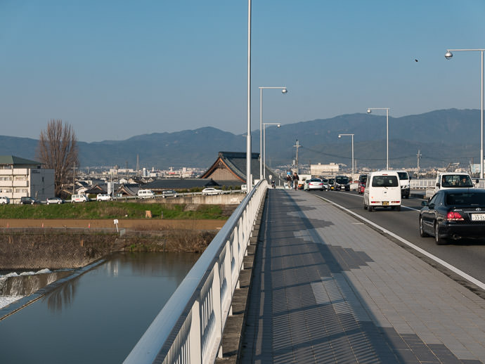 About To Enter the Mountains (well, they're still 9km away, but I'm heading there) -- Kuga Bus Stop -- Kyoto, Japan -- Copyright 2017 Jeffrey Friedl, http://regex.info/blog/