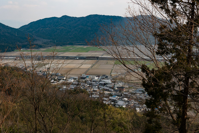 Bullet Train Crossing the Plain the white line from the center to the right edge of the screen ( with the first mountain we climbed sitting there in the background ) -- Omihachiman, Shiga, Japan -- Copyright 2017 Jeffrey Friedl, http://regex.info/blog/ -- This photo is licensed to the public under the Creative Commons Attribution-NonCommercial 4.0 International License http://creativecommons.org/licenses/by-nc/4.0/ (non-commercial use is freely allowed if proper attribution is given, including a link back to this page on http://regex.info/ when used online)