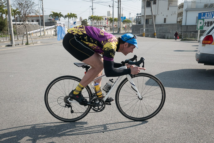 Test Riding Yasuko's Bike seems a smidge on the small side photo by Jason Eisenmenger -- 65-17 -- Yaese-cho, Okinawa, Japan -- Copyright 2018 Jeffrey Friedl, http://regex.info/blog/