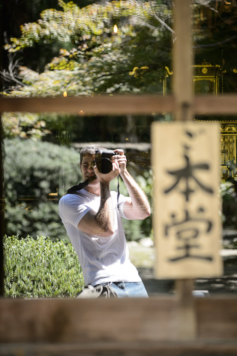 "Self Portrait in the window of the main hall (the sign says ""main hall"")  --  Kajuuji Temple (勧修寺)  --  Kyoto, Japan  --  Copyright 2012 Jeffrey Friedl, http://regex.info/blog/"