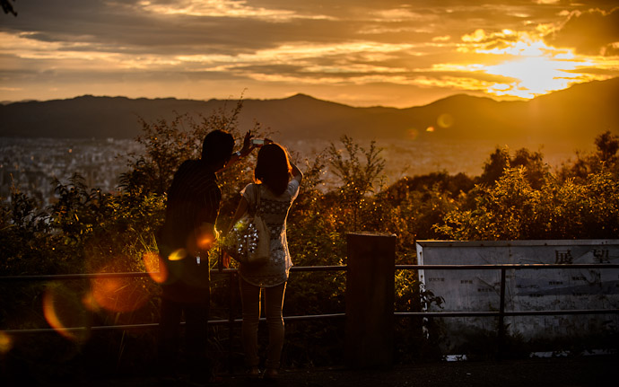 desktop background image of a nice sunset over Kyoto, Japan, from the Shogunzuka Overlook ()  --  Shogunzuka ()  --  Copyright 2012 Jeffrey Friedl, http://regex.info/blog/