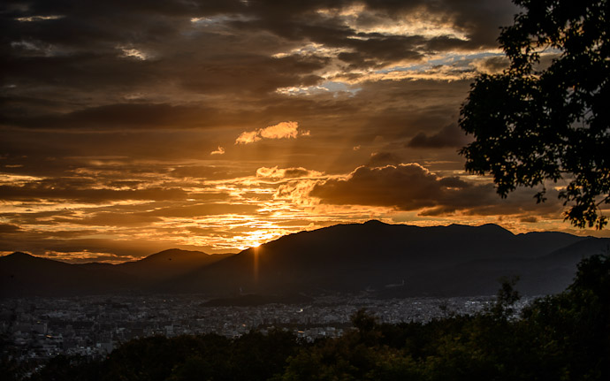 desktop background image of a nice sunset over Kyoto, Japan, from the Shogunzuka (将軍塚) overlook  --  Nite Nite Mr. Sun  --  Shogunzuka (将軍塚)  --  Copyright 2012 Jeffrey Friedl, http://regex.info/blog/