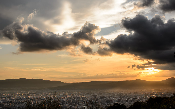 desktop background image of a colorful sunset over Kyoto  --  A Bit Dynamic  --  Shogunzuka (将軍塚)  --  Kyoto, Japan  --  Copyright 2012 Jeffrey Friedl, http://regex.info/blog/
