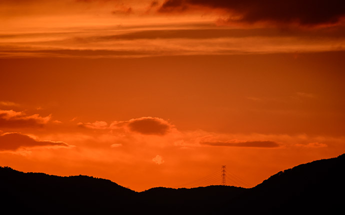 desktop background image of a colorful sunset over Kyoto  --  Looks Like a Bridge power-line tower is 14.3km (9mi) away  --  Shogunzuka (将軍塚)  --  Kyoto, Japan  --  Copyright 2012 Jeffrey Friedl, http://regex.info/blog/